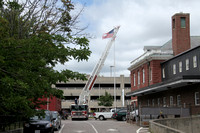 Brockton Ladder 1 replaces a flag at 32 Crescent St